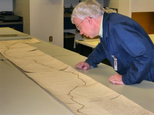 Archivist Randy Goss examines the 1825 document.