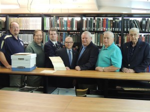 Delaware Society of the Sons of the American Revolution (DESSAR) members join Delaware Public Archives Director Stephen M. Marz for the donation of the DESSAR membership applications. From left: Troy Foxwell, first vice president; George Contant, member; Michael Keen, historian; Director Marz; George Jones, president; George Locke, secretary; Jack Lewis, past president.