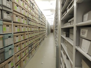 After documents are humidified, arranged, boxed and described, they find a home on a shelf in one of our vaults.