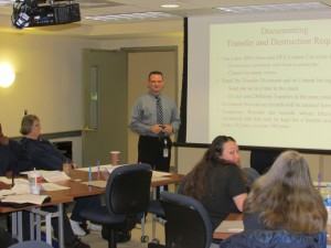 Government Services Manager Kit Carson trains state record officers.