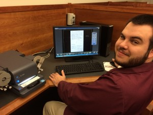 Reference archivist Rich Hays demonstrates DPA's new microfilm scanner.