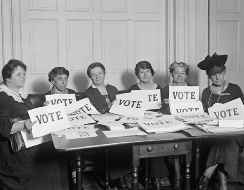 Photo of women holdings signs advocating the right to vote