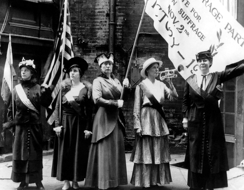 Photo of Members of the Women's National Party holding flags and a banner